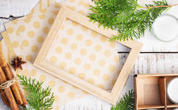 Picture frame, craft paper and christmas tree brunches on white Stock Photography