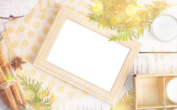 Picture frame, craft paper and christmas tree brunches on white Royalty Free Stock Photography