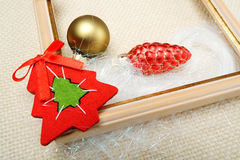 Picture frame decorated with Christmas toys close-up Stock Photos