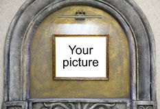 Picture frame in the decorative arch on the wall Royalty Free Stock Photo
