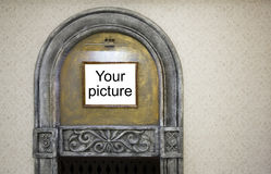 Picture frame in the decorative arch on the wall Royalty Free Stock Photography