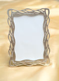 Picture Frame with diamond on Satin. Silver diamond picture frame on a light orange satin Stock Photo