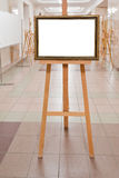 Picture frame on easel in art gallery Stock Photography