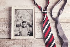 Picture frame. With family photo and two ties laid on wooden backround Stock Photos
