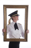 In a picture frame female airline pilot Royalty Free Stock Photos