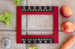 Picture frame with fruits and vegetables Royalty Free Stock Photos