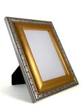 Picture frame - gold and silver 01. A gold and silver picture frame shot at a 3/4 angle Royalty Free Stock Photo