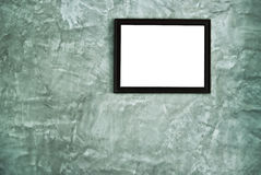 Picture frame hanging on the wall Stock Photography