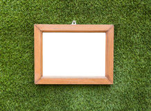 Picture frame hangings on artificial grass background Stock Image