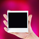Picture frame in her hand Royalty Free Stock Images