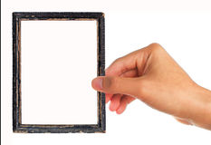 Picture of frame with human hand holding Stock Photos