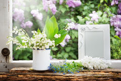 Picture frame, lily of the valley and lilac Stock Photography