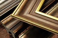 Picture frame mouldings. Modern gold picture frame mouldings Royalty Free Stock Photos