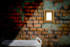 Picture frame on the old brick wall Royalty Free Stock Photo