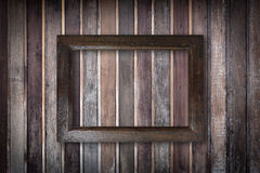 Picture frame on old wooden wall Stock Photo