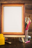 Picture frame and paints on wood Stock Photography