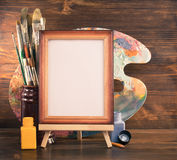 Picture frame and paints on wood Royalty Free Stock Photos
