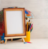 Picture frame and paints on wood Stock Photos