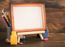 Picture frame and paints on wood Stock Photo