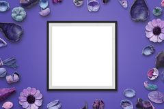 Picture frame on purple desk with flower decorations Royalty Free Stock Photography