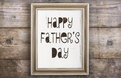 Picture frame. Rectangle picture frame with Happy fathers day sign laid on wooden floor backround Stock Photo