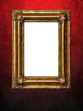 Picture frame on red grungy wall Stock Images