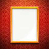 Picture frame on red wallpaper. Golden picture frame on red wall, vintage wallpaper background Royalty Free Stock Photography
