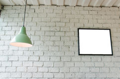 Picture frame in room with ceiling lamp Stock Images