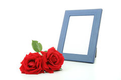 Picture frame with rose flowers Stock Photos