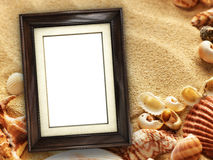 Picture frame on shells and sand background Stock Photo