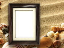 Picture frame on shells and sand background Royalty Free Stock Photography
