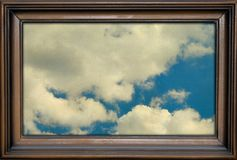 Picture frame with sky and clouds Royalty Free Stock Photos