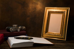 picture frame on table with vintage camera and diary book Royalty Free Stock Photo