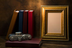 picture frame on table with vintage camera and diary book Royalty Free Stock Photos