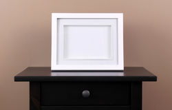 Picture frame on table. Picture frame on wooden table stock photography