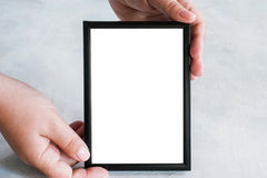 Picture frame tenderly holding in hands Royalty Free Stock Photo
