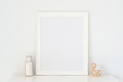 Picture frame and a vase on the table & wood Stock Photo