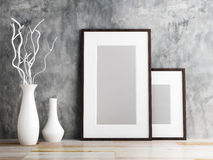 Picture frame and vase on wood floor Royalty Free Stock Photography