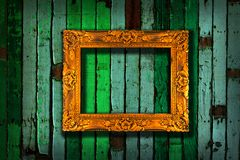 Picture frame on vintage green painted wooden stock images