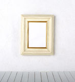 Picture frame on a wall. Old frames over the white wall background stock image