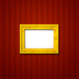 Picture Frame on wall. Golden photo frame hanging alone on the wall Stock Photography