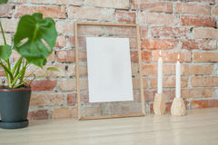 Picture frame on wall. Empty picture in wooden frame where you can write your text, hanging on brick wall Stock Photography