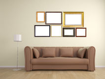 Picture frame on wall and sofa furniture interior Stock Photography