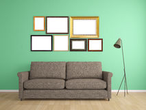 Picture frame on wall and sofa interior furniture Royalty Free Stock Photos
