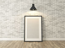 Picture frame on the white brick wall and wood. Floor under spot light for picture, background, template, advertising rendering Royalty Free Stock Image