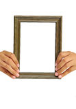 Picture frame in woman hand Royalty Free Stock Images