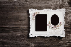 Picture frame on wood texture background Stock Photos