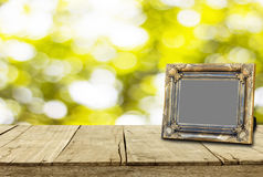 Picture frame on wooden floor and bokeh for background texture Royalty Free Stock Images