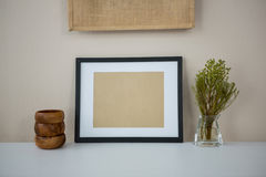 Picture frame with wooden pencil holder and vase Stock Images