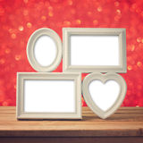 Picture frame on wooden table over bokeh background Royalty Free Stock Image